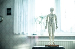 Acupuncture model of person with meridian points