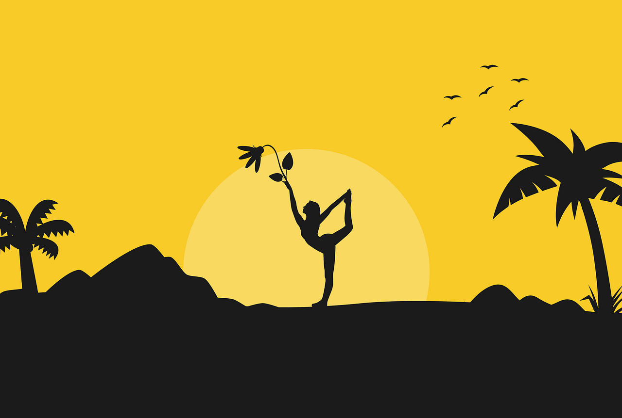 Silhouette of woman doing yoga during sunrise