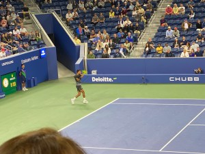 Felix Auger Aliassime playing tennis at 2021 U.S. Open on Armstrong stadium