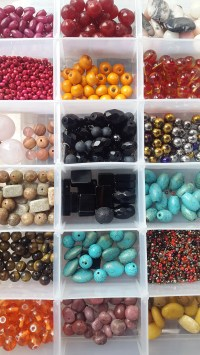A variety of colours of wood, glass and gemstones