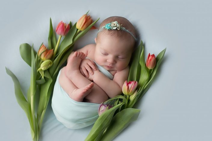 Baby Photo Shoot Glasgow - baby on mint background with tulips
