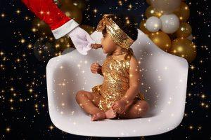 Family Photographer Renfrewshire - santa feeding cookie to baby
