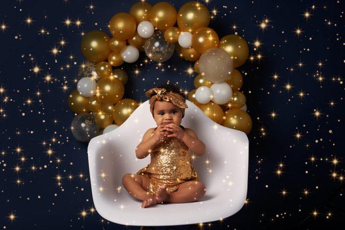 Family Photographer Renfrewshire - baby girl in gold romper