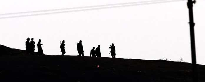 Members of Islamic State (IS) on the Syrian side of the border with Turkey, near Sanliurfa, Turkey, 06 October 2014.