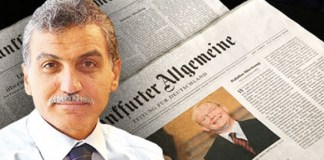 Hidayet Karaca und im Hintergrund die FAZ-Zeitung