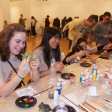Girls making crafts with varied art supplies