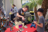Man showing Lego creations