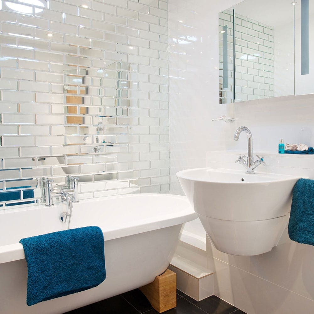 Easy decorating tricks to make your tiny bathroom look ... on Small Space Small Bathroom Tiles Design  id=25626