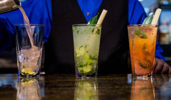 Drink and Beverage photographers in Dallas Fort Worth show three mojitos being poured