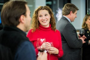 women smiling and conversing at a holiday Christmas party in Dallas
