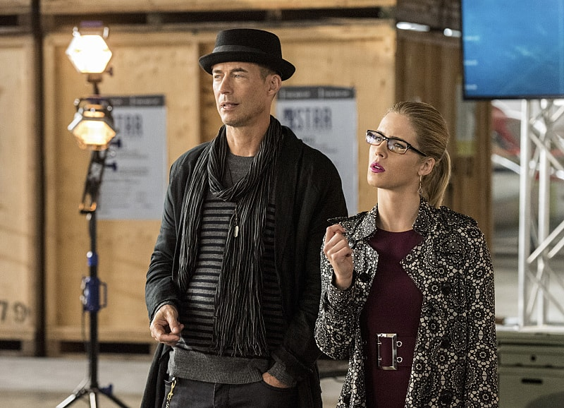 "The Flash -- ""Invasion!"" -- Image FLA308b_0258b.jpg -- Pictured (L-R): Tom Cavanagh as Harrison Wells and Emily Bett Rickards as Felicity Smoak -- Photo: Dean Buscher/The CW -- © 2016 The CW Network, LLC. All rights reserved."