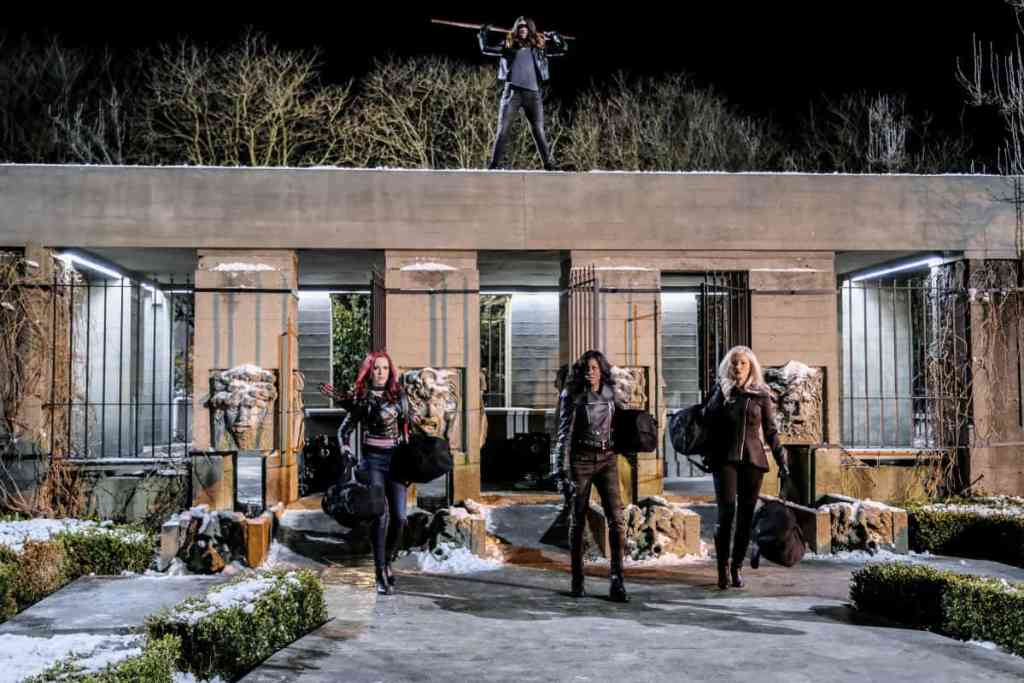 """Arrow -- """"The Sin-Eater"""" -- Image AR514b_0083b.jpg -- Pictured (Top): Juliana Harkavy as Tina Boland/Dinah. Bottom (L-R): Amy Gumenick as Carrie Cutter/Cupid, Rutina Wesley as Liza Warner, and Kelly Hu as China White -- Photo: Robert Falconer/The CW -- © 2017 The CW Network, LLC. All Rights Reserved."""