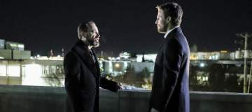 """Arrow -- """"Disbanded"""" -- Image AR518a_0003b.jpg -- Pictured (L-R): David Nyki as Anatoly Knyazev and Stephen Amell as Oliver Queen -- Photo: Bettina Strauss/The CW -- © 2017 The CW Network, LLC. All Rights Reserved."""