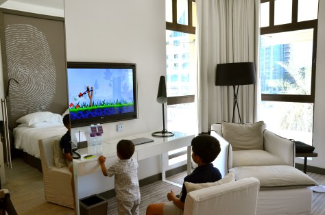 Kids playing ANGRY BIRDS on 42-inch flat screen IPTV