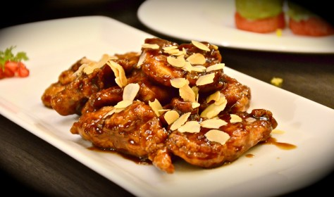 Espresso Chicken - dhs 52 -Crispy chicken chunk coated with a special fragrant espresso coffee sauce & topped with toasted almond flakes