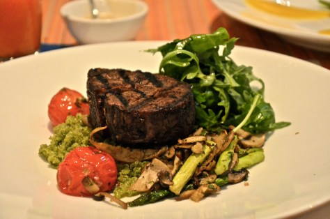 120 day aged Australian Beef Tenderloin - AED 220 with Rocket salad, pesto quinoa, tomatoes, mushroom sauce