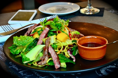 Asian Beef Noodle Salad - Aed 42 - Grilled steak, mango, tossed greens, scallions, peanuts & sesame soy dressing