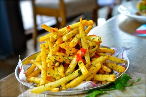 LOGMA FRIES - AED 28 - Fries seasoned with Khaleeji spices and crisp herbs
