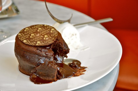 Chocolate Lava Cake - AED 48 - A Cocoa rich cake with Godiva Tourbillon 72% chocolate baked served with Godiva chocolate and vanilla ice cream