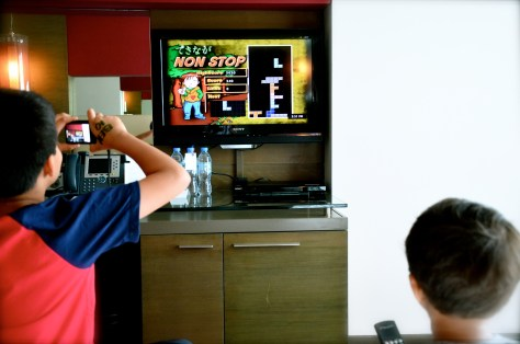 Kids enjoying playing games in the interactive TV inside the master bedroom