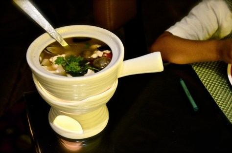 Tom Yam Zaab Soup(AED 40) - spicy clear soup with cherry tomato, mushroom and red onion