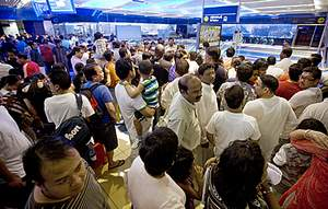 A queue of passengers waits to go through the boarding turnstiles at the Khalid Bin Al Waleed station yesterday. Jeff Topping / The National