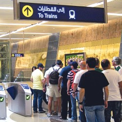 The first ride: Commuters wait to have their tickets 'read' before boarding the Metro on the first day of its public launch at the Union Square station in Dubai © XPRESS/Virendra Saklani