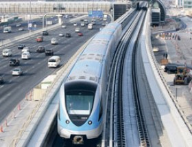 Hadrian Hernandez/Gulf News A Metro train makes a trial run on the Red Line on Shaikh Zayed Road. The Metro, which opens today, will help commuters reach strategic areas of the city, and will also branch out into the suburbs through future extensions.
