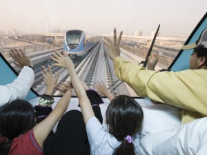 DUBAI METRO: Some of the first passengers wave to an oncoming train. (ITP Images)