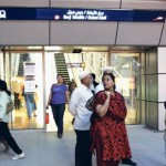 *  Commuters wait outside the Burj Khalifa Metro Station during a disruption in the service yesterday.