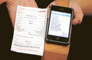 *  Image Credit: Abdel-Krim Kallouche/Gulf News     * A dejected motorist shows Gulf News his parking ticket and the SMS warning he received from the Dubai Roads and Transport Authority.