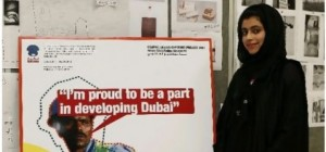 Emirati Hessa al Hasshimi, 21, a graduating graphic design student with one of her posters at Zayed University.