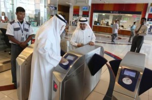 *  Image Credit: Francois Nel/Gulf News     * Commuters scan their tickets to enter the Dubai Metro's Health Care City Station on Saturday.