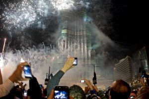 Spectators photograph the fireworks at the Burj Khalifa on New Year's Eve in Dubai last year. Jeff Topping / The National
