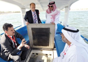 Guy Wolfensberger explains to officials about Grove Boats during WFES 2012 at the Abu Dhabi National Exhibition Centre. — KT photo by Nezar Balout