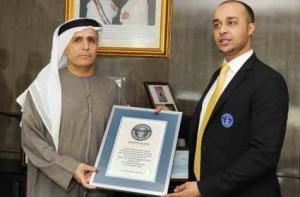 *  Image Credit: Supplied photo     * Mattar Al Tayer (left), Chairman of the Board and Executive Director of the Roads and Transport Authority, receives the Guinness certificate from Talal Omar, Regional Director of Guinness Book of World Records in the Middle East.
