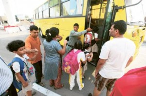 Image Credit: Gulf News archives     Pupils get on a school bus on Oud Metha Road. Al Dossary said there had been a 'revolution' in school transport since the RTA took it over in 2008.