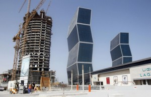 Construction cranes operate near Zig Zag Towers in Doha, Qatar September 25, 2012. / REUTERS