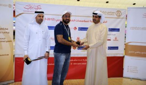 Sultan Al Marzouqi receives the best player award from Dr. Ahmed Al Sharif general secretary of DSC while Nasser Al Rahma also from DSC, looks on. (SUPPLIED)