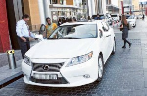 Image Credit: Virendra Saklani/Gulf News Visitors using one of the recently launched luxury taxies by RTA at Dubai mall.