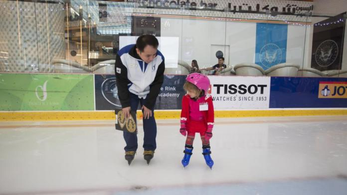 Dubai Ice Rink Coach and Girl Child