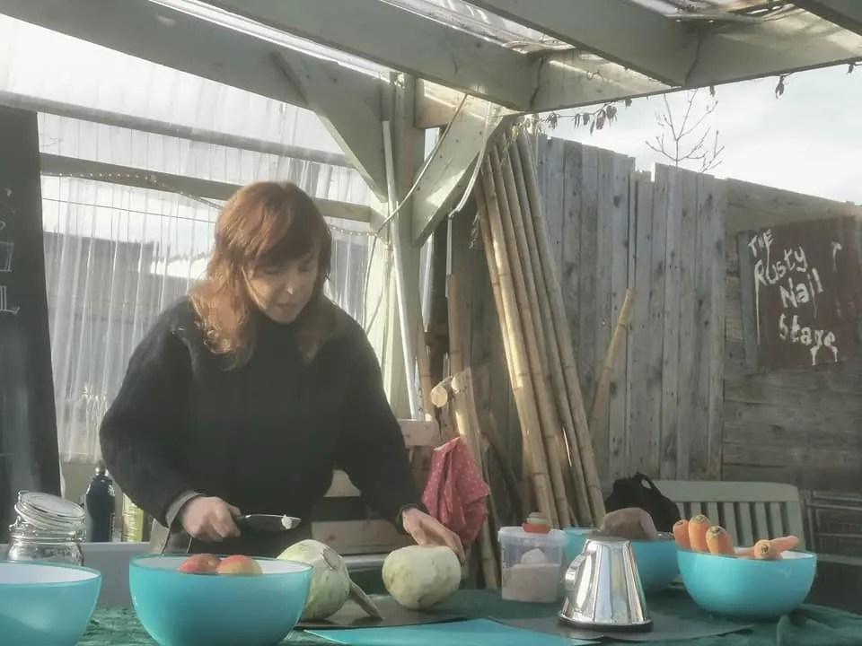 Niamh demonstrating how to make sauerkraut