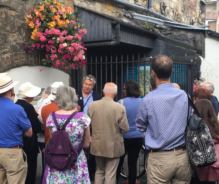 Arran Henderson reading the city with guests, on a recent Dublin Decoded North side Medieval Tour