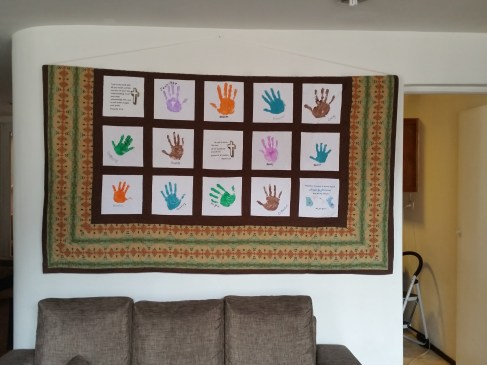 I finally hung up our families handprint blanket...only took me 5 months in Cusco!