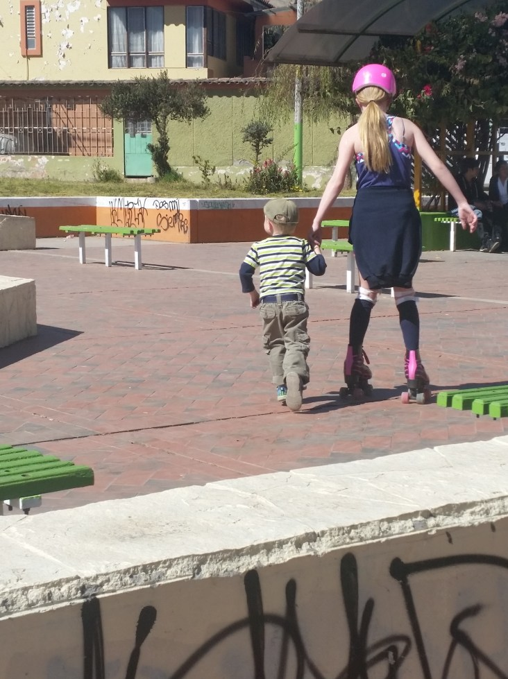 Emma skating at the park with our little missionary buddy.