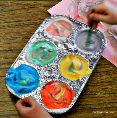 Mixing food coloring into shaving cream for homemade paints #preschool #kidsactivities