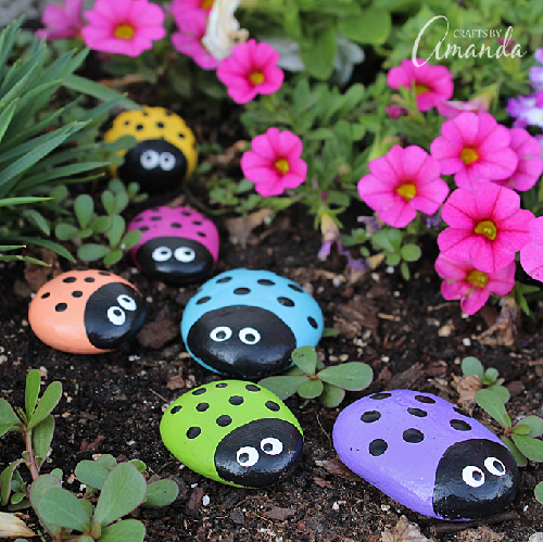 Painted lady bug rocks for an adorable garden decoration