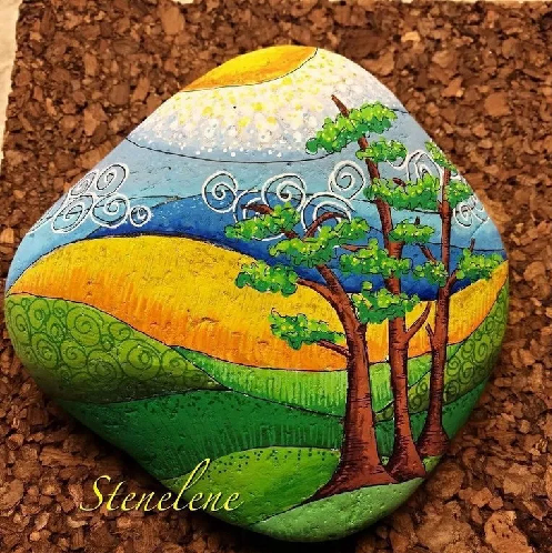 Inspiring painting of a tropical terrain under the sunshine painted on a rock