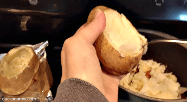 Scoop out the cooked insides of the baked potatoes for making twice baked potatoes