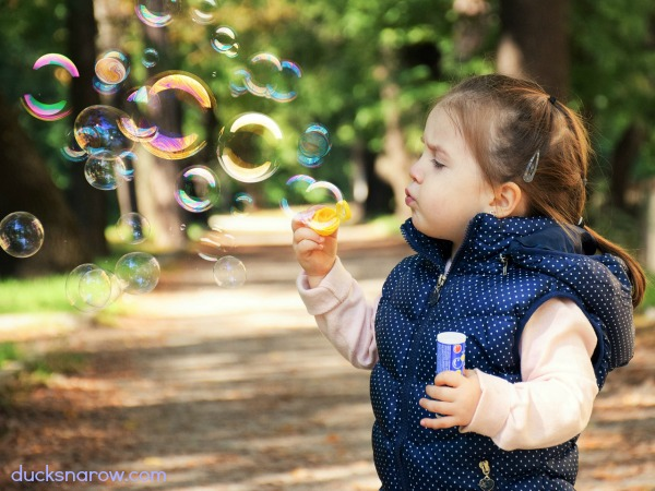 Little girl blowing bubbles #kids #ad